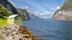Small hut in Undredal, Norway. Small hut in Undredal with the fjord in the background, Norway Royalty Free Stock Images