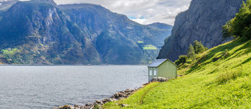 Small hut in Undredal, Norway. Small hut in Undredal with the fjord in the background, Norway Royalty Free Stock Photo