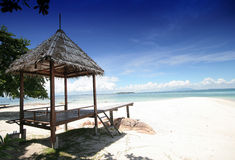 Small Hut on White Beach and Blue Sky Royalty Free Stock Images