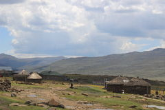 Small huts close to the Lesotho border control in the Sani Pass Stock Photo