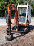 Small hydraulic excavator Stock Images