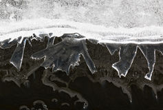 Small ice figures reflecting from water surface Royalty Free Stock Images
