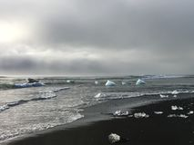 Small icebergs swept up on the black sand at Diamond beach in Iceland. Small icebergs swept up on the black sand at Diamond beach in south east Iceland Stock Photo