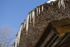 Small Icicles Retro Straw Roof Background Blue Sky Stock Photos