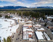 Aerial view of McCall Idaho in winter with mountain range backdr Stock Images