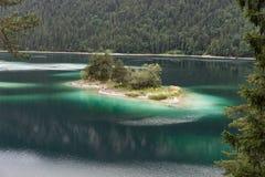Small idyllic island in the Eibsee near Grainau in Bavaria Stock Photos