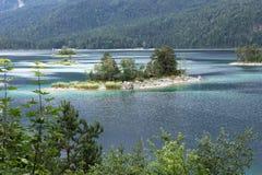Small idyllic island in the Eibsee near Grainau in Bavaria Stock Images