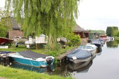Small idyllic Dutch village with boats along canal Royalty Free Stock Image