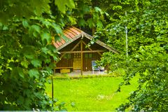 Small idyllic wooden hut in the woods of Bavaria, Germany royalty free stock image