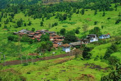 Small Indian village by railroad Stock Images