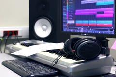 Production Studio with Keyboard Speaker Headphones