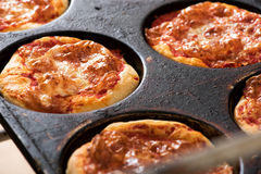Small individual pizzas in a baking tray Stock Image