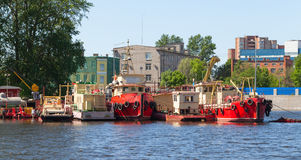 Small industrial boats are moored on river Royalty Free Stock Photos
