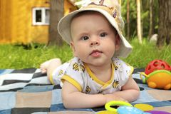 A small infant in a hat resting in the summer Royalty Free Stock Images