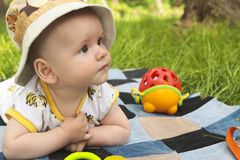 A small infant in a hat resting in the summer Royalty Free Stock Photography