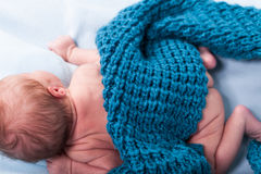 Small infant wrapped in knitted fabric Stock Photo