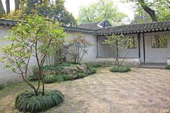A small internal Chinese courtyard and trees. City of Shanghai.  royalty free stock photo