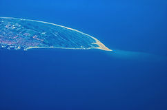 Small island. The tip of a small island seen from above Stock Photos