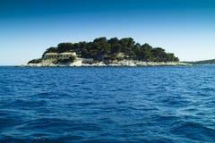 Small island in the Adriatic sea. Small island part of Pakleni otoci near Hvar island in Croatia stock image