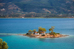Small island in Aegean sea. Near Poros, Greece Stock Photography