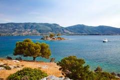Small island in Aegean sea. Near Poros, Greece Royalty Free Stock Image