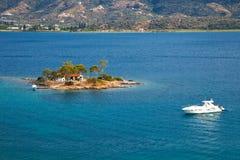 Small island in Aegean sea. Near Poros, Greece Royalty Free Stock Images