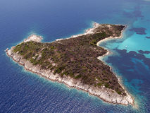 Small island aerial view. Aerial view of a small aegean island near Chalkidiki Greece royalty free stock photo