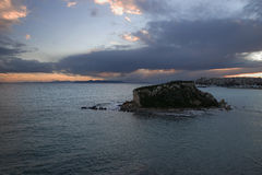 Small island in athens at sunset Royalty Free Stock Images
