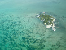 Small island in belize. Flying from corozal to caye caulker in belize you may find this small paradisiatic island in the caribbean Royalty Free Stock Image