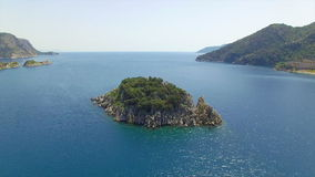 Small island in blue sea stock footage