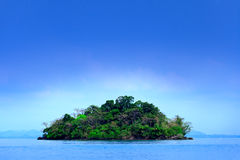 Small island and blue sky Royalty Free Stock Photo