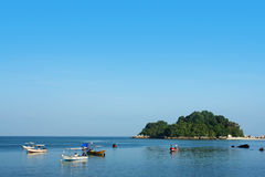 Small island and boat Royalty Free Stock Photo