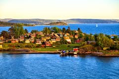 A small island with closely spaced houses, Norway Royalty Free Stock Photo