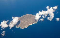 Small island and clouds Royalty Free Stock Image