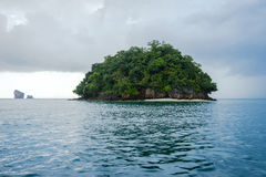 Small island and cloudy sky after rain royalty free stock photos