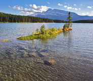 Small island in cold Canadian lake Stock Photography