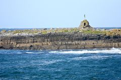 Doolin Pier, county Clare, Ireland. Small island at the entrance of Doolin`s Bay, The Burren, County Clare, Ireland Royalty Free Stock Image