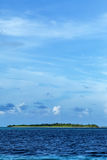A small island. Far away Royalty Free Stock Photography