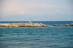 Small Island with Flag Royalty Free Stock Photos