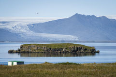 Small island in Iceland. A small island in front of a glacier in Hornafjörður, Iceland Royalty Free Stock Images