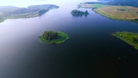 Small island in lake stock footage