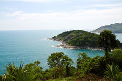 A small island lies off the coast of Phuket Stock Image