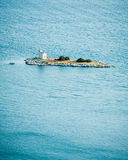 Small island with a lighthouse in the Adriatic Sea. In Croatia royalty free stock images