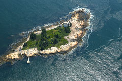 Small Island with lighthouse in the Gulf of Maine, Aerial View Stock Images