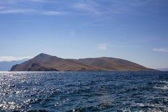 Small island with lighthouse, island Krk, Croatia.  stock photos