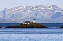 Small island with lighthouse in Norway Stock Photography