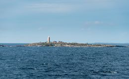 Small island and lighthouse outside Stockholm, Sweden Stock Photos