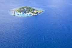 Small island in maldives. A aeroshot view of a small island in maldives Royalty Free Stock Photos