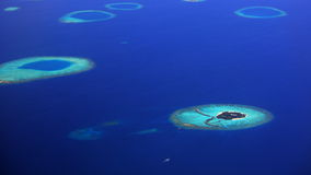A small island in maldives. Aerial view of a small luxurious resort at Maldives Royalty Free Stock Photos