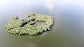 Small island. In the middle of the lake, visit Romania stock footage